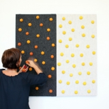 Dark grey and light grey panel with yellow and orange dots