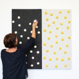 Dark grey and light grey panel with white and yellow dots